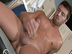 Etienne Pauliac fingering his uncut cock in the locker room