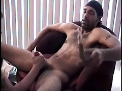 Enrique strips down to his socks and a stocking cap and in seconds his cock,..