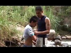 Diego fishing in a beautiful mountain stream, when Hernán comes. Hernan..