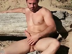 Surf buddy Brock captured on camera to masturbate on the beach