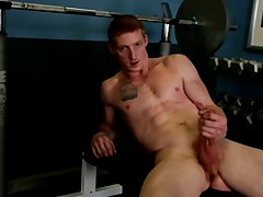 Avid gym nut Max grabs his huge cock and beats off