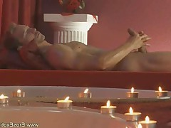 Hunk guy gives himself a gentle massage of the penis.
