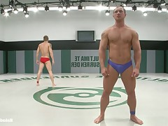 Huge bodybuilder with a big fat cock fights and fucks a hot ripped blond stud.
