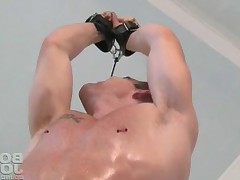 This hot guy tied up and ready for his cock sucked!