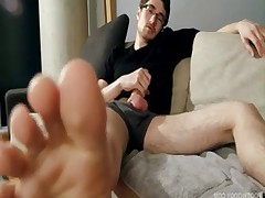 Jake props his beautiful 10.5 bare feet on the table, he reaches into his..